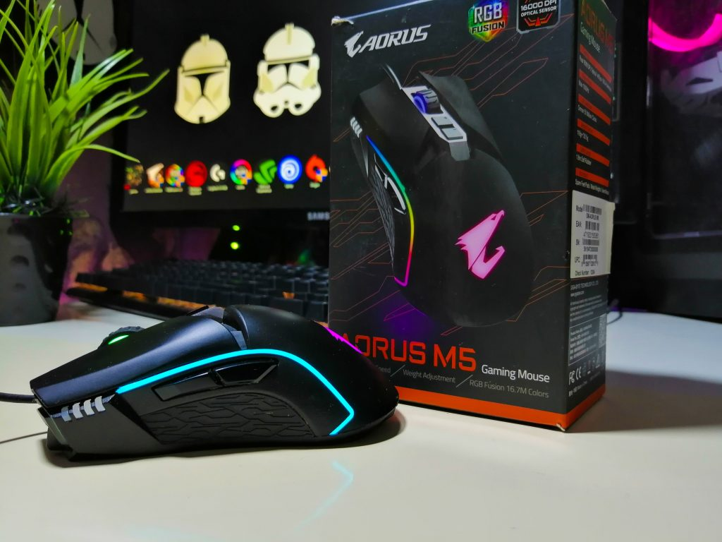 Gaming Mouse casually placed by its box